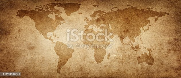 istock Old map of the world on a old parchment background. Vintage style. Elements of this Image Furnished by NASA. 1128196221
