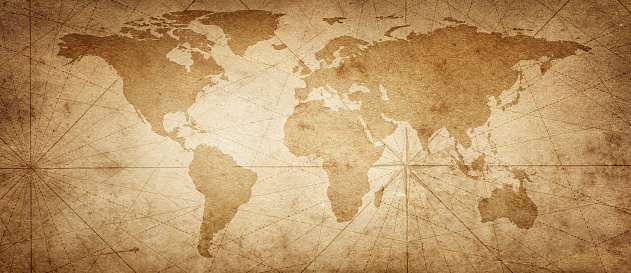 istock Old map of the world on a old parchment background. Vintage style. Elements of this Image Furnished by NASA. 1128196229