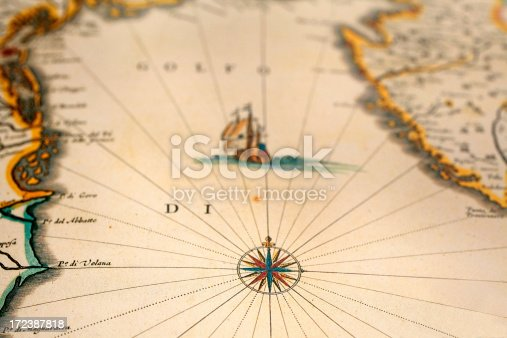 istock old map with ship and compass 172387818