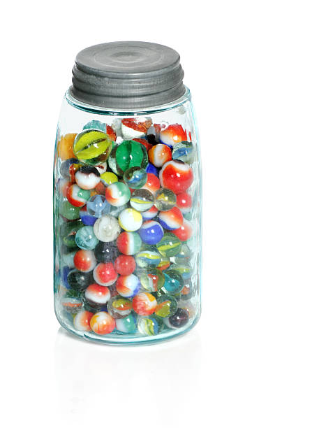 Old Marbles In Mason Jar stock photo
