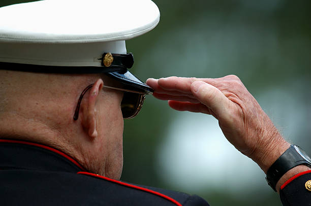 old marine salutes - saluting stock photos and pictures