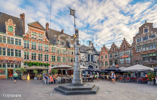 Old Market Square, Ghent, Belgium. Ghent is a port city at the confluence of the Leie and Scheldt rivers and a municipality in the Flemish Region of Belgium. Local people and tourists are enjoying in cafes and restaurants.