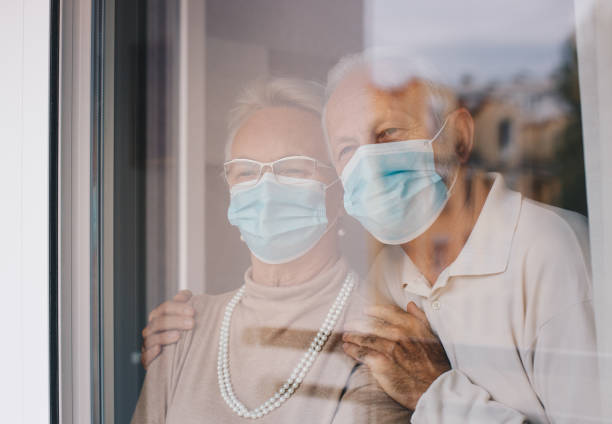 Old married couple hugging stock photo