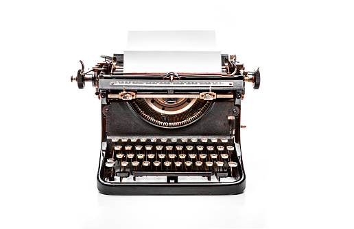 Old mechanical typewriter on a white background