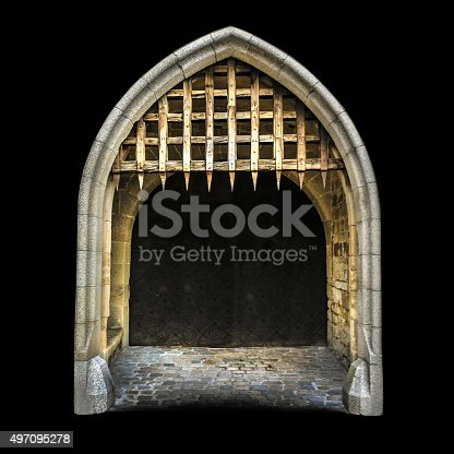 Old medieval (gothic) castle entrance, with stone wall, closed gate and spiked wooden grate, isolated on black background.
