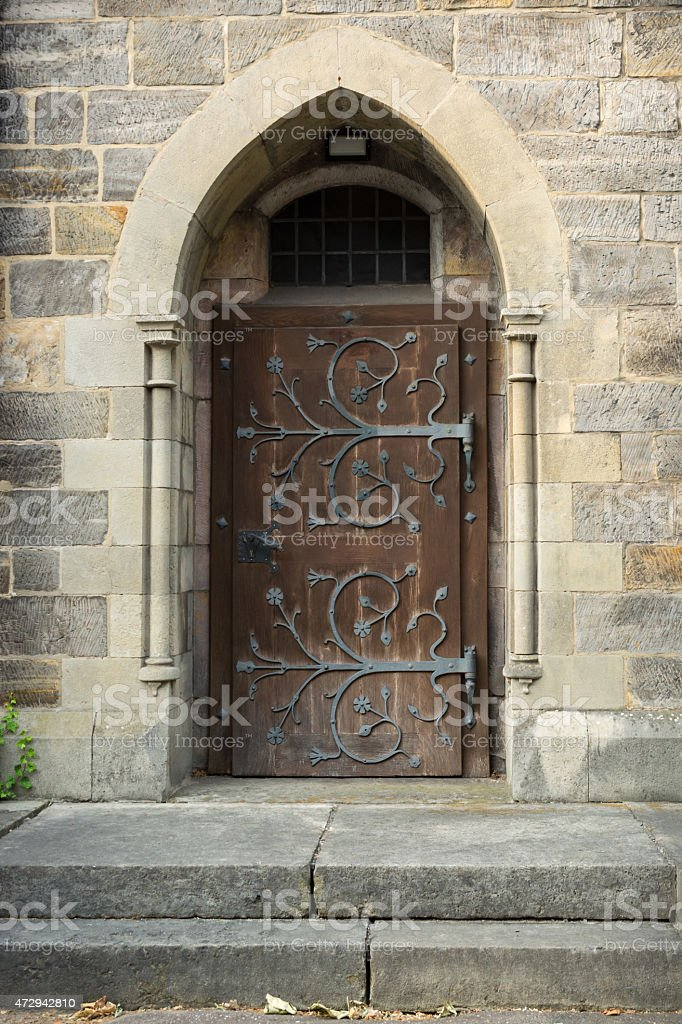 Old medieval church doorway, with ornate ironwork, Hannover, Germany stock photo