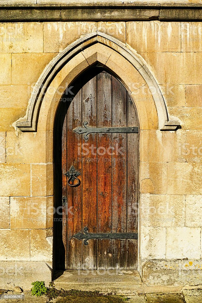 Old medieval church/castle wooden door in stone wall. stock photo & Royalty Free Medieval Door Pictures Images and Stock Photos - iStock