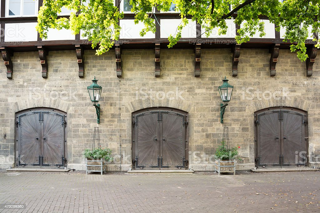 Old medieval doors with ornate ironwork, Hannover, Germany stock photo