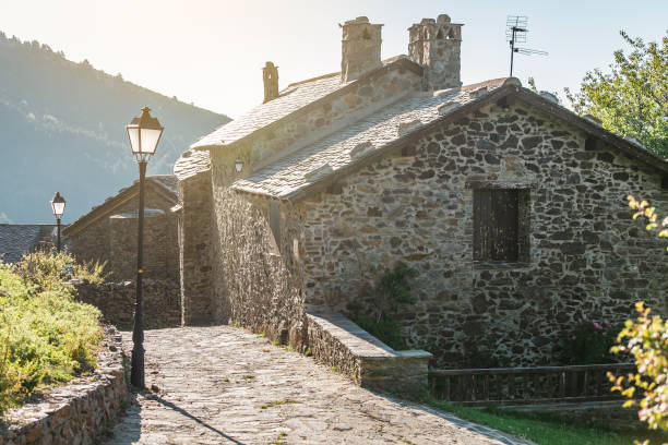 Old Medieval stone Village Dorria in Pyrenees mountains Old Medieval stone Village Dorria in Pyrenees mountains stone house stock pictures, royalty-free photos & images