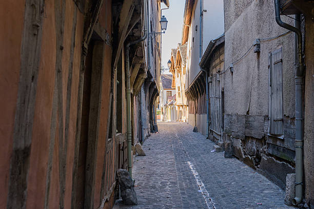 old medieval street with timbered houses in Troyes old medieval street with timbered houses in Troyes, France, sunshine is at end of street aisne stock pictures, royalty-free photos & images