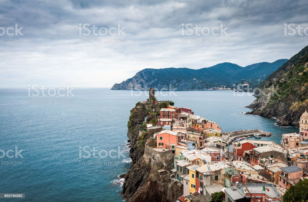 Old medieval watchtower and old houses on cliffs stock photo