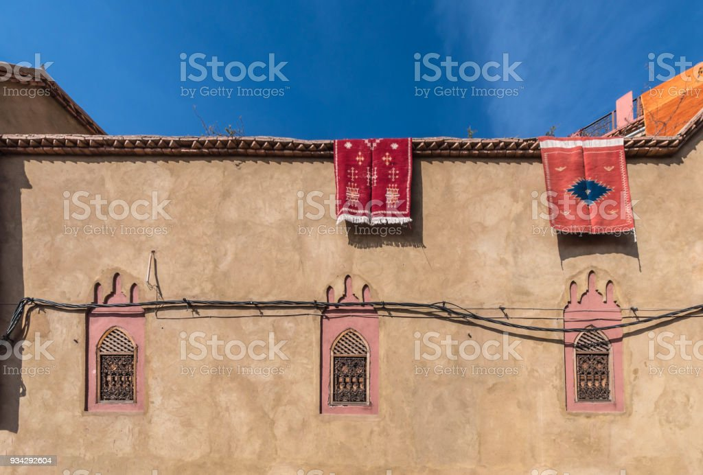 Old Medina Walls in Marrakesh with hanging rugs stock photo