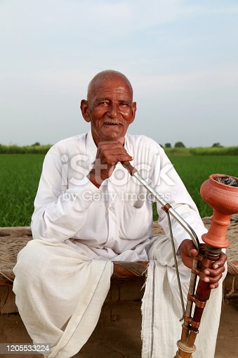 istock Old Men Enjoying Hookah 1205533224