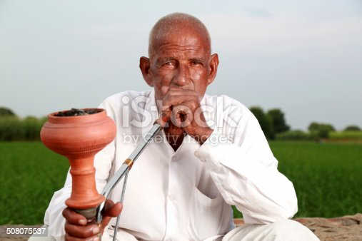 istock Old Men Enjoying Hookah 508075537