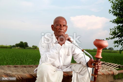 istock Old Men Enjoying Hookah 508075553