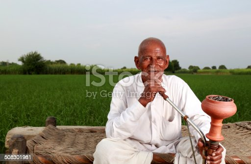 istock Old Men Enjoying Hookah 508301981
