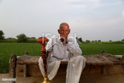 istock Old Men Enjoying Hookah 508440453