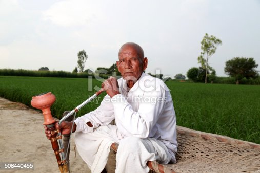 istock Old Men Enjoying Hookah 508440455