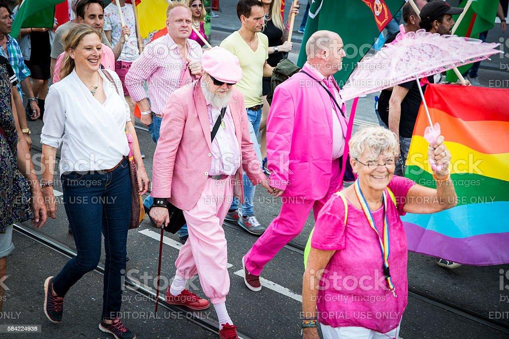 old men holding hand at Pride Walk, Amsterdam Gay EuroPride stock photo