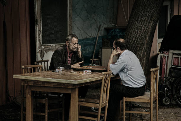 old men playing backgammon in buyukada in istanbul - backgammon stock pictures, royalty-free photos & images