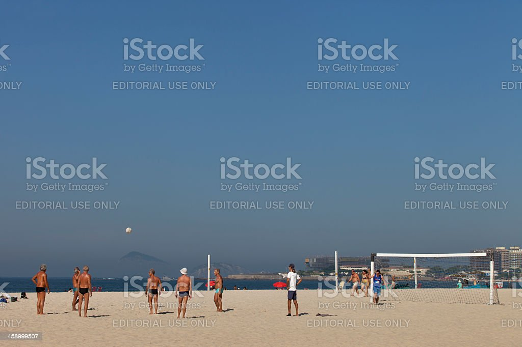 Old men playing soccer in Copacabana stock photo