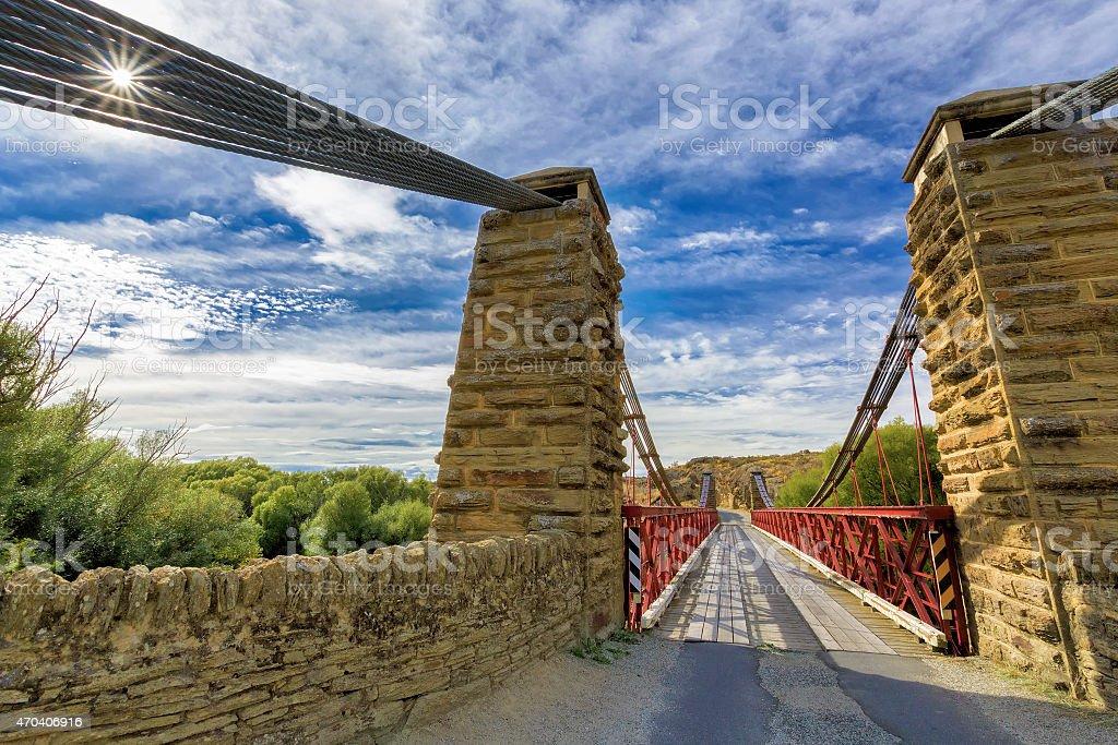 Old metal and stonework bridge stock photo