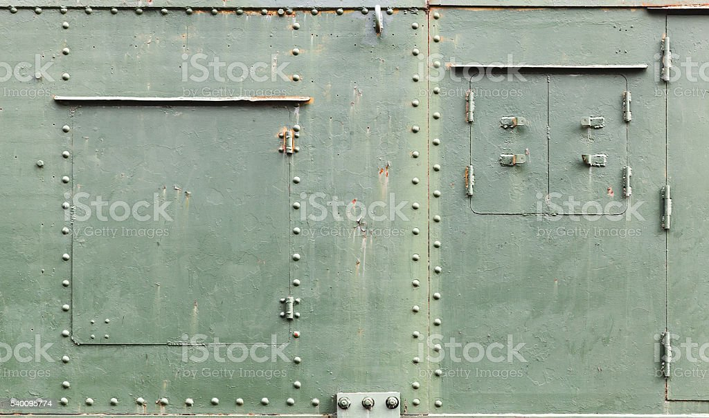 Old metal background texture with manholes stock photo