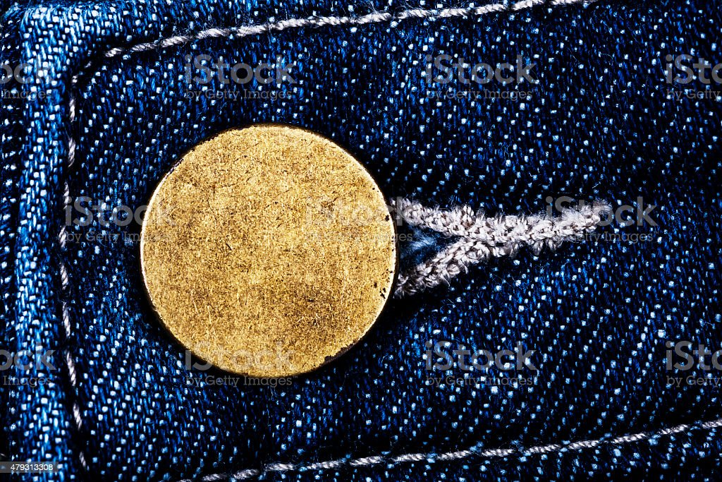 Old metal button of jeans stock photo