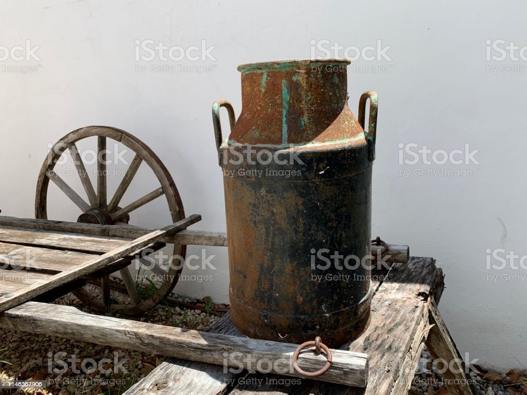 Strange Old Metal Dairy Boat On Wooden Bench Stock Photo Download Evergreenethics Interior Chair Design Evergreenethicsorg