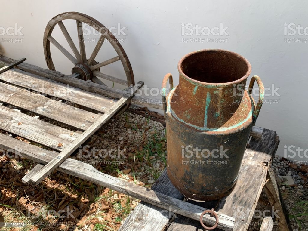 Brilliant Old Metal Dairy Boat On Wooden Bench Stock Photo Download Evergreenethics Interior Chair Design Evergreenethicsorg