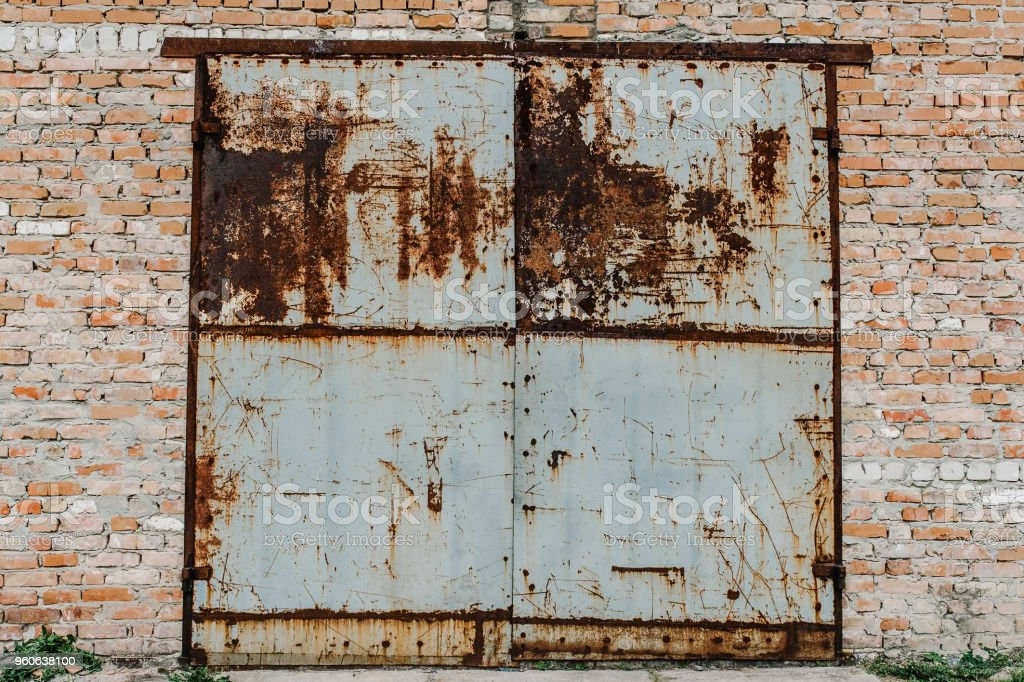 Attrayant Old Metal Door From The Garage Rusty Garage Old Red Bricks Barn Gray Garage  Door In An Old House Stock Photo   Download Image Now