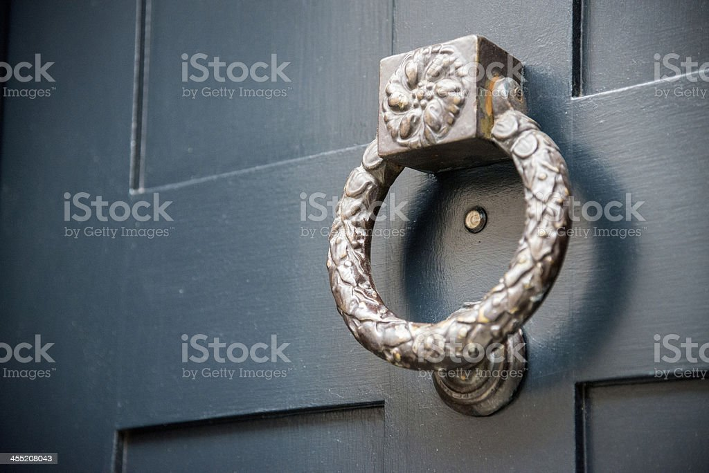 Old metal door knocker stock photo