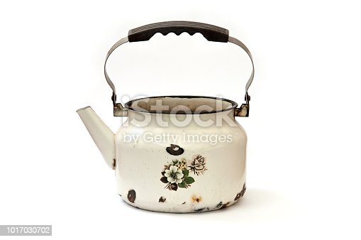 old metal enamel kettle isolated on white background