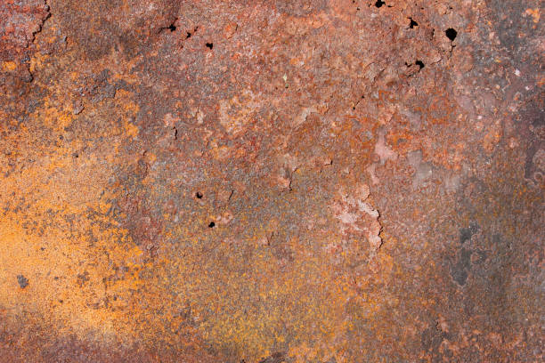 old metal exfoliating sheet with red and yellow rust, holes and cracks, texture - detachment stock pictures, royalty-free photos & images