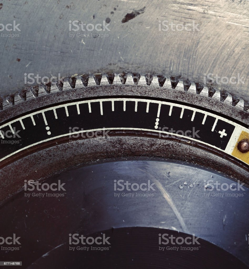 Old metal flywheel with scale stock photo