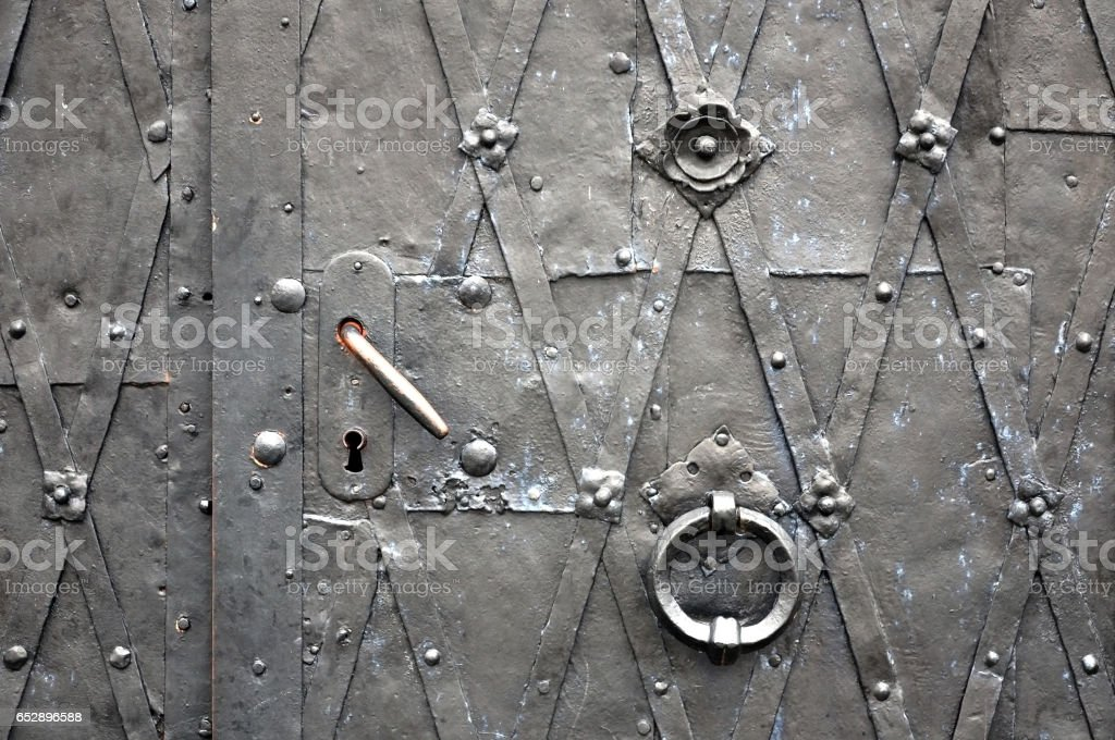Old metal gate texture with a door handles. stock photo