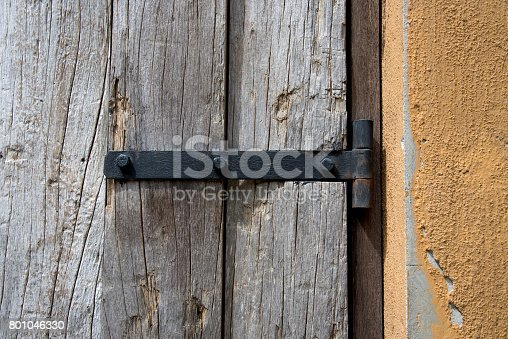 1178501072istockphoto Old metal hinge and nut fixed on wooden door 801046330