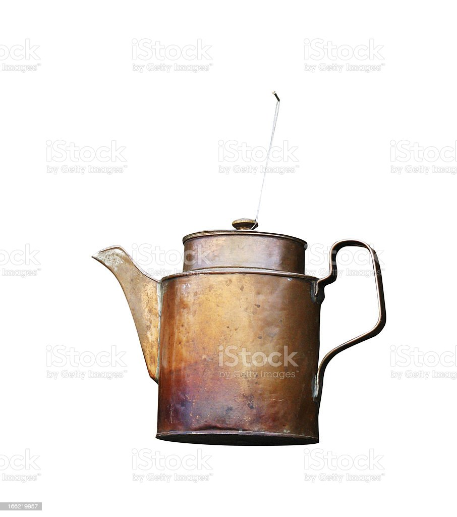 Old metal kettle hangs on a nail royalty-free stock photo