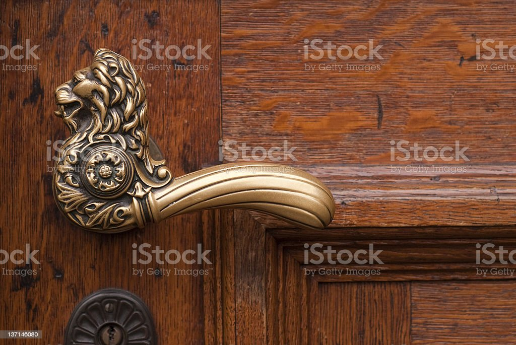 Old metal lion handle of a door royalty-free stock photo