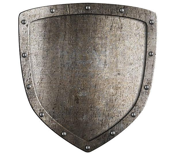 Vieux métal bouclier médiéval. Motif d'écusson. - Photo