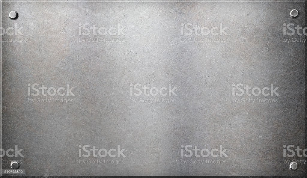 old metal plaque with rivets stock photo