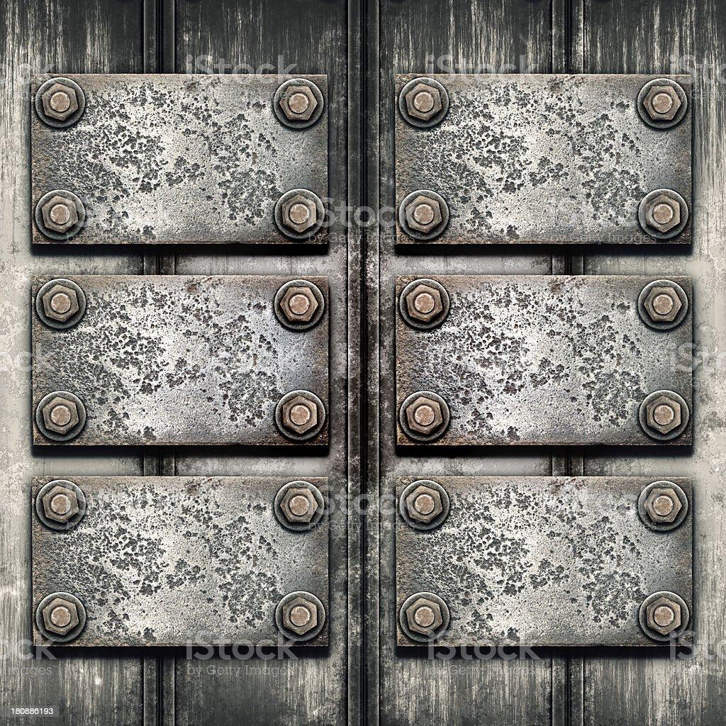Old metal plate on metallic wall royalty-free stock photo
