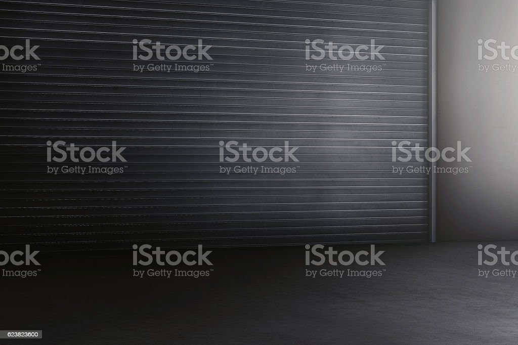 Old metal rolling door in dark style stock photo