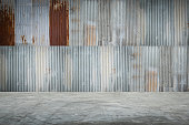 Old metal sheet roof texture with concrete floor. Abstract background.