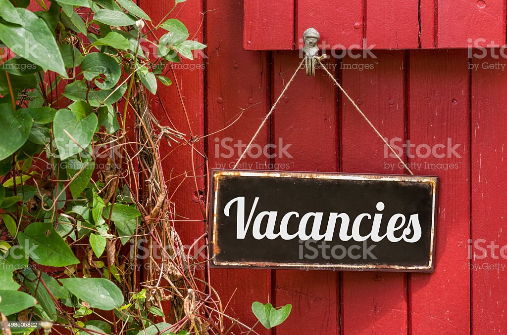Old metal sign with the inscription Vacancies stock photo