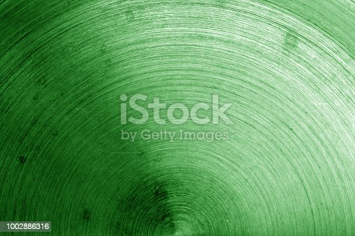 istock Old metal surface with scratches in green tone 1002886316
