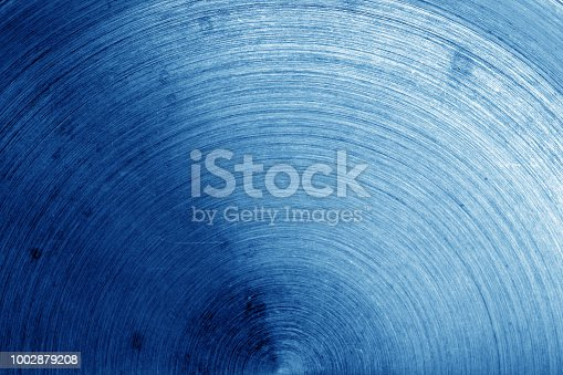 938345942 istock photo Old metal surface with scratches in navy blue tone. 1002879208