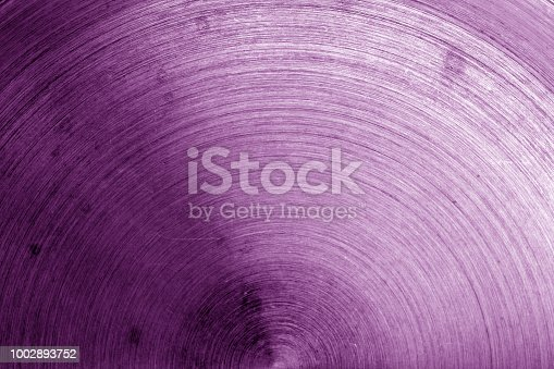 938345942 istock photo Old metal surface with scratches in purple tone. 1002893752