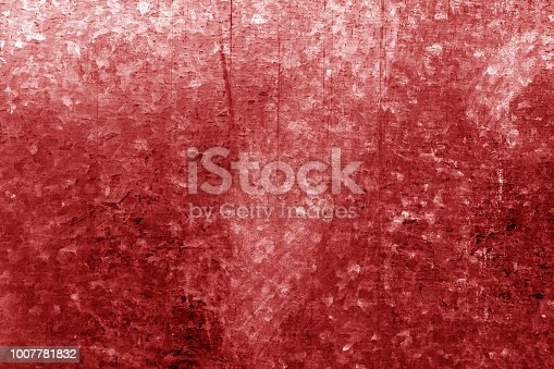 istock Old metal surface with scratches in red tone 1007781832