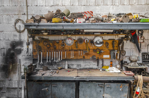 old metal table in a metalwork shop filled with tools old metal table in a metalwork shop filled with tools workbench stock pictures, royalty-free photos & images